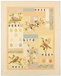 Soft quilt with sweet applique birds, flowers, eggs and a nest