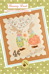"A vintage ""stamp"" wall hanging with an embroidered postmark and two adorable rabbits"